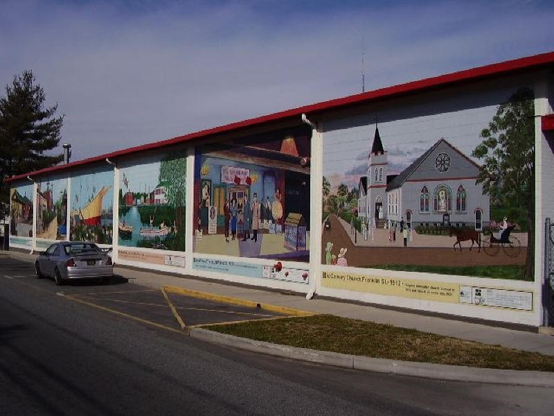 Milford mural by Mispillion Art League. showing town scenes