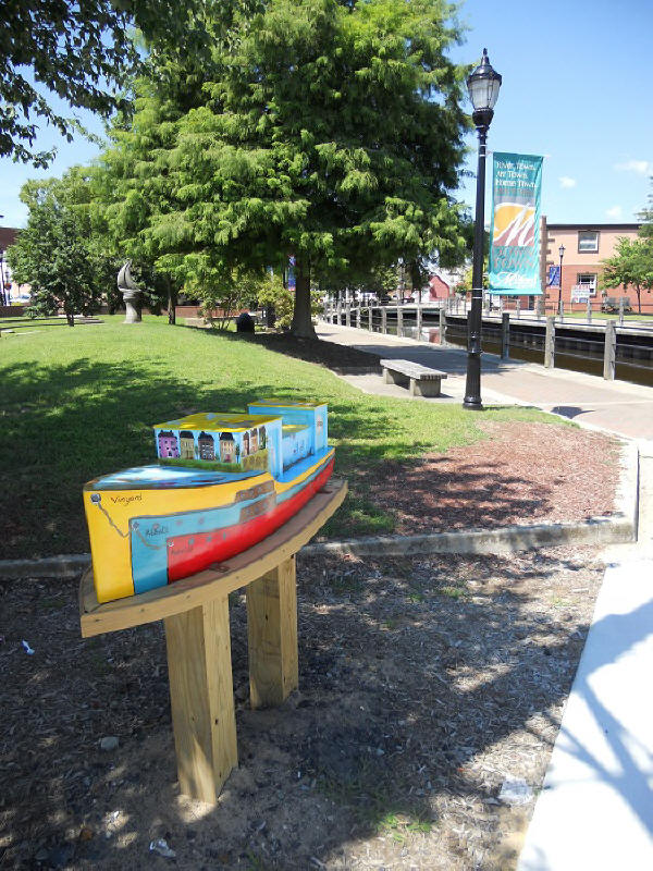 Downtown Milford's Art on the Riverwalk Tour ship deptiting shipbuilding history and bird life