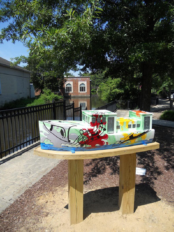 Downtown Milford's Art on the Riverwalk Tour ship deptiting community