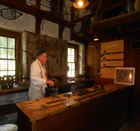 Gun smith at gunshop  at Landis Valley Village and Farm Museum located near Lancaste