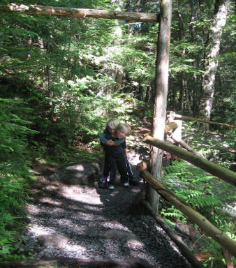Hugging a child on trail near Natural Stone Bridge and Caves in Pottersville, New York