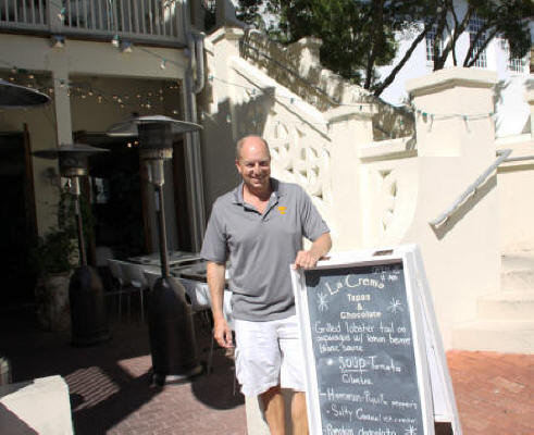 Kevin Neel, owner of La Crema poses in front of restaurant at Rosemary Beach, Florida