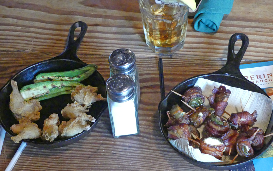 Jalepeno                                       Bites and Quail legs served in                                       small cast iron pans