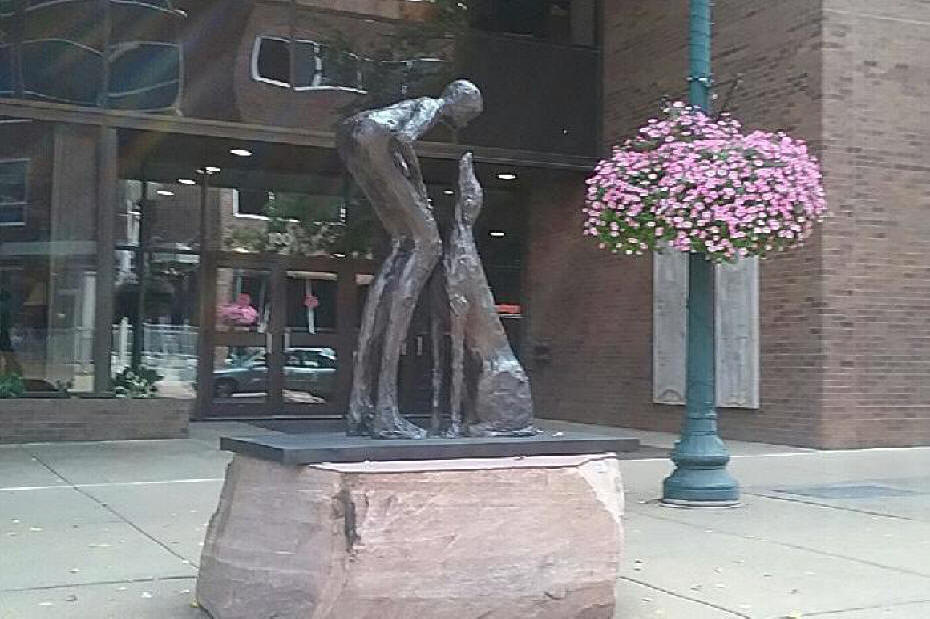 sculpture of young woman and greyhound