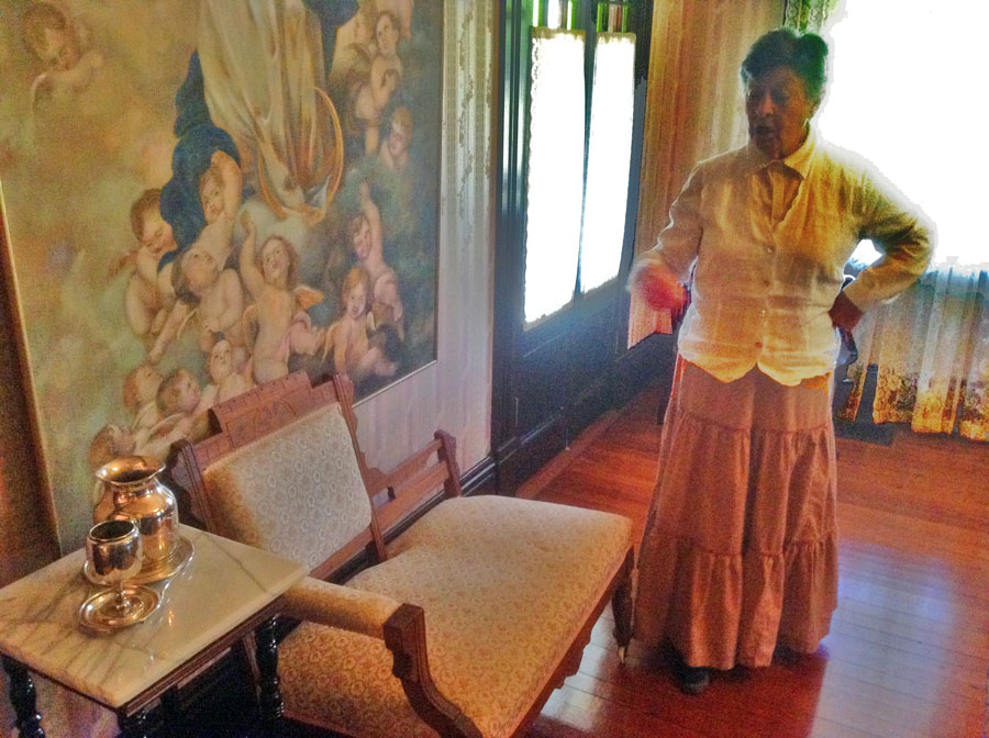 docent shows off furnishings at Tift House at Georgia Agrirama