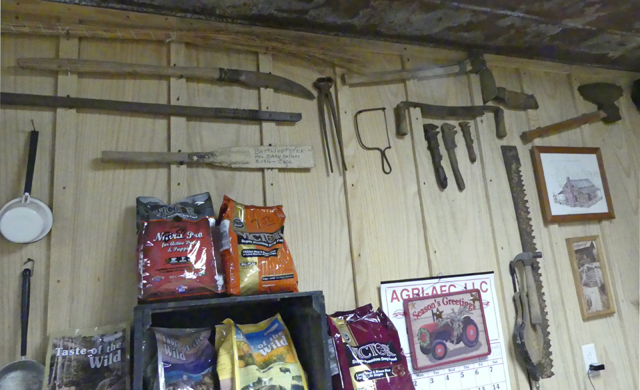 Joe's grandfather's cane striper and other tools on the office wall at Todd Syrup Farm