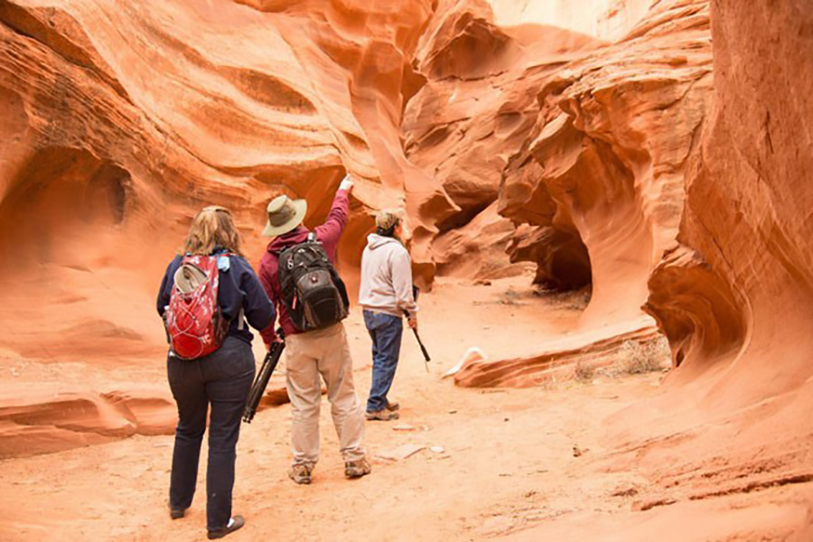 group of photograhoers look up at  slot canyons in Page, AZ