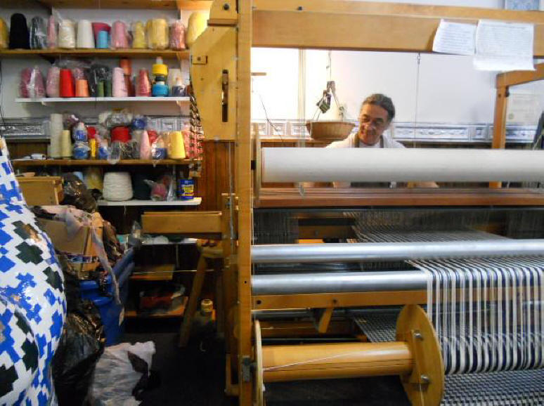 Neil Colmer weaves on his loom in Weaver's Bottom.