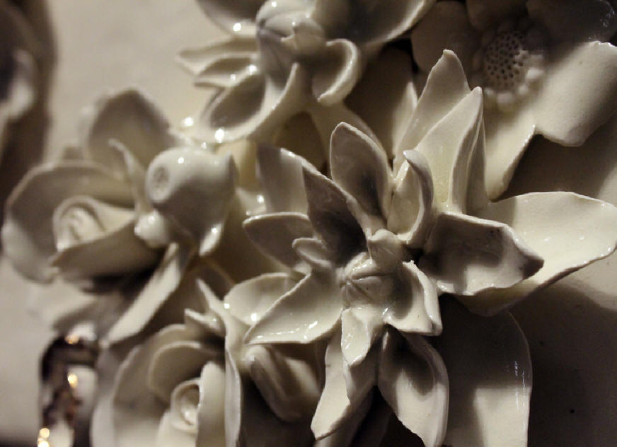 intricate floral designs in clay by Tricia Taylor of Berea, Ky,