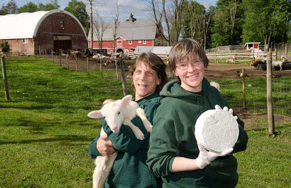 owners of Nettle Meadow Farm holding goast and cheese