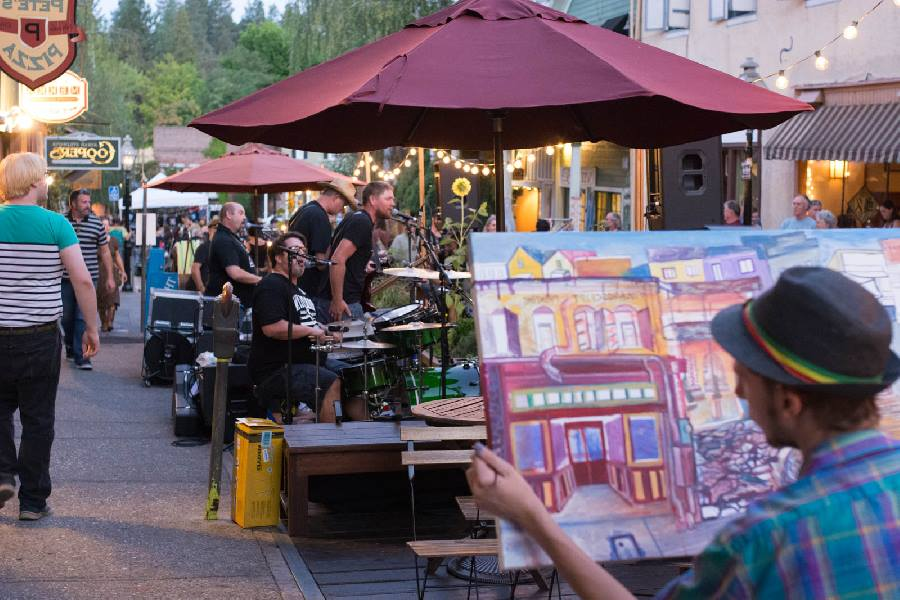 Local artist Kyle Kingston live paints to the music of MAU at The Nevada City Boardwalk