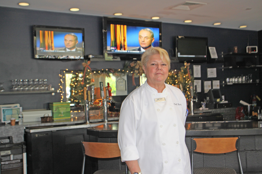 Chef Rusty Evers in front of bar at Waterworks Bar and Grill at Barrymore Hoitel in Tampa