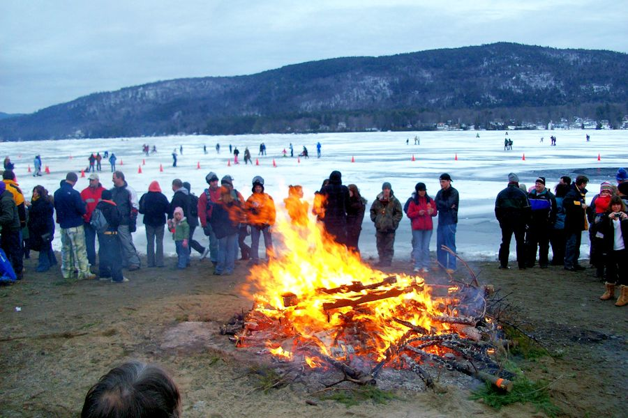 bonfire on the shores of Lake George in winter