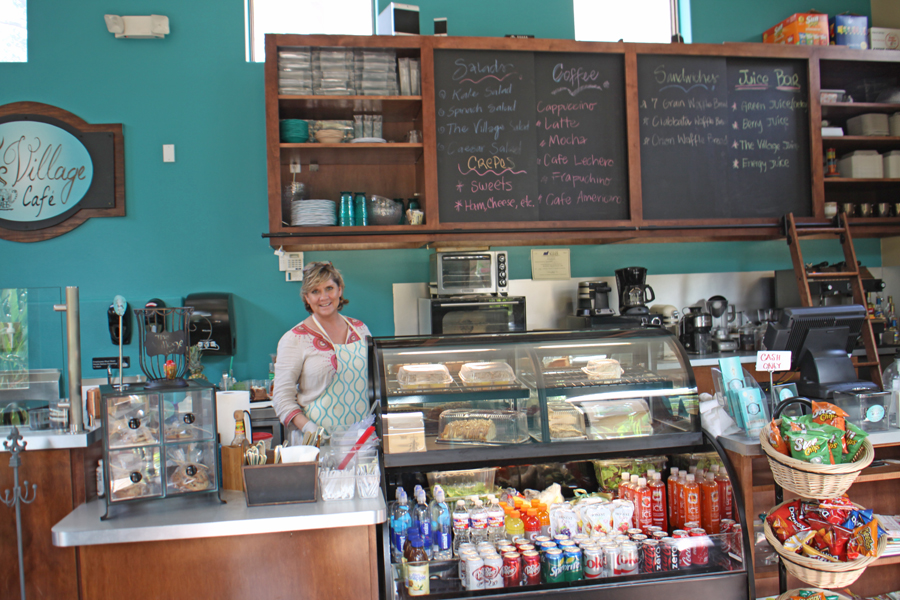 The Village Café  with owner behind counter