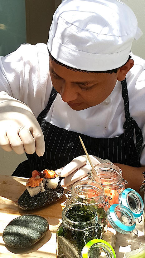 Chef Mauricio Lopez preparing a dish