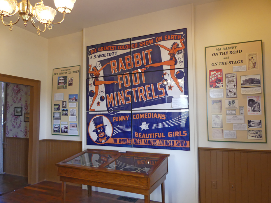 posters in Ma Rainey;s house mainly one for Rabbits Foot Minstrals