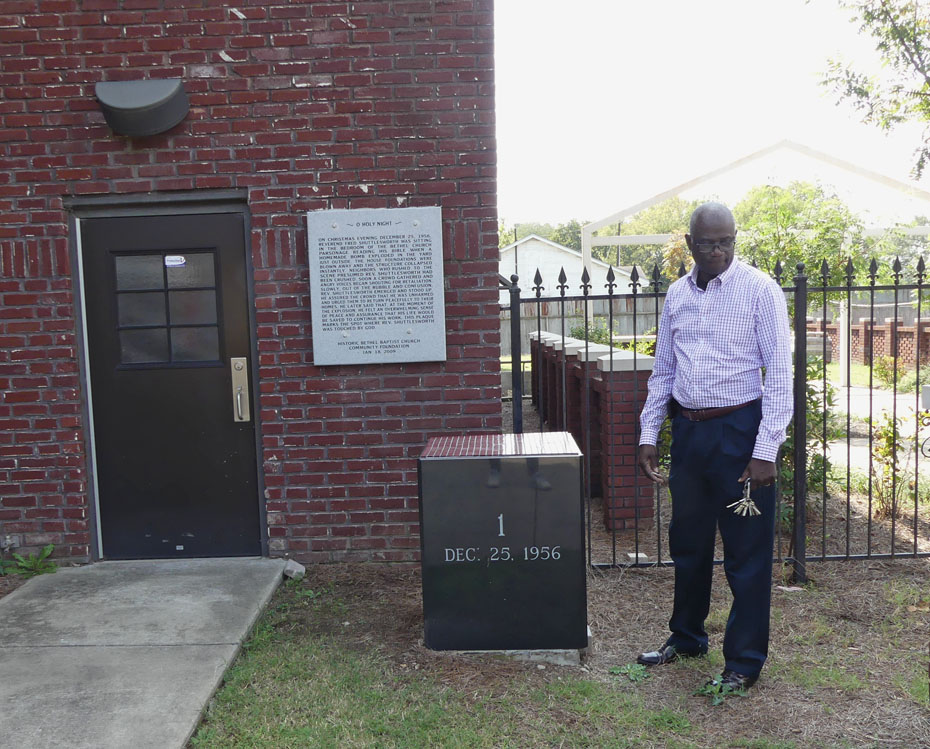 Paster shows placque commemorating Bethel Baptist Church bombing