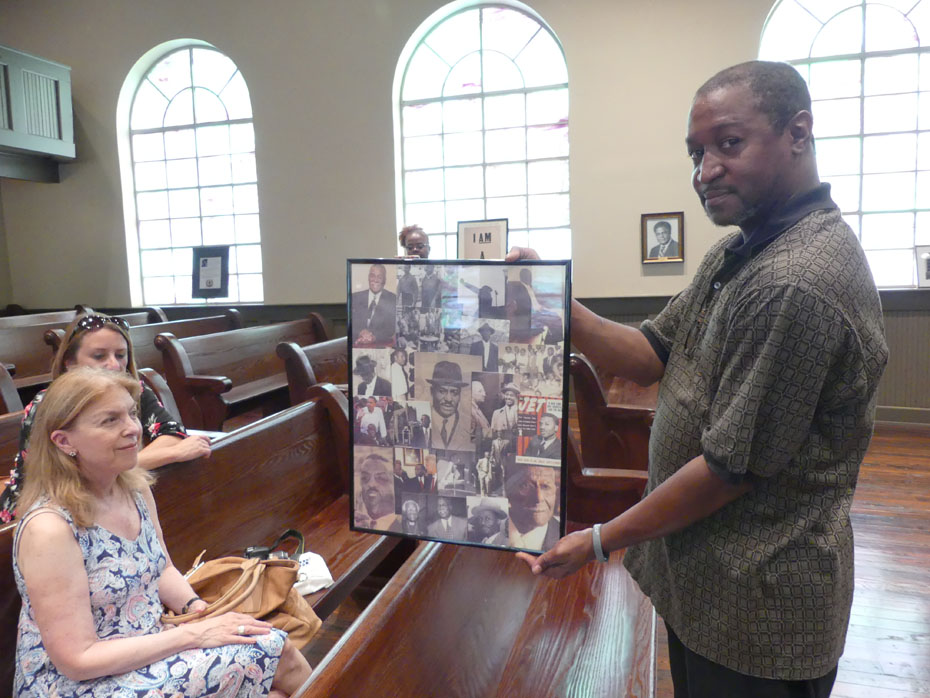 Man showing visitors information  inside Bethel Baptist Church