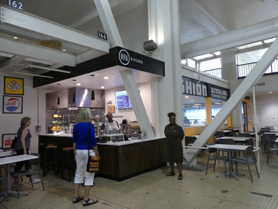 Two restaurant stalls at Pizitz Food Hall in Birmingham