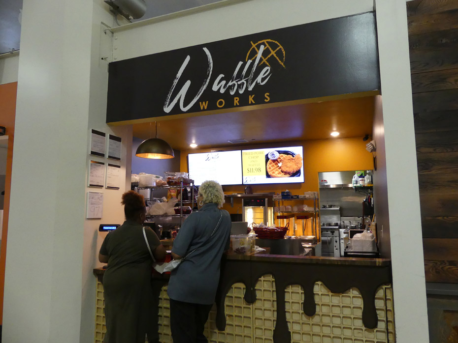 Two women ordering at  Waffel Works in Pizitz Food Hall in Birmingham