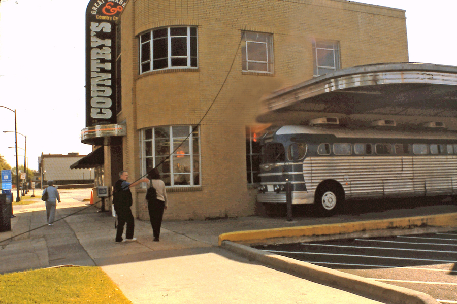Country's exterior with diner bus on side of building in Columbus, GA