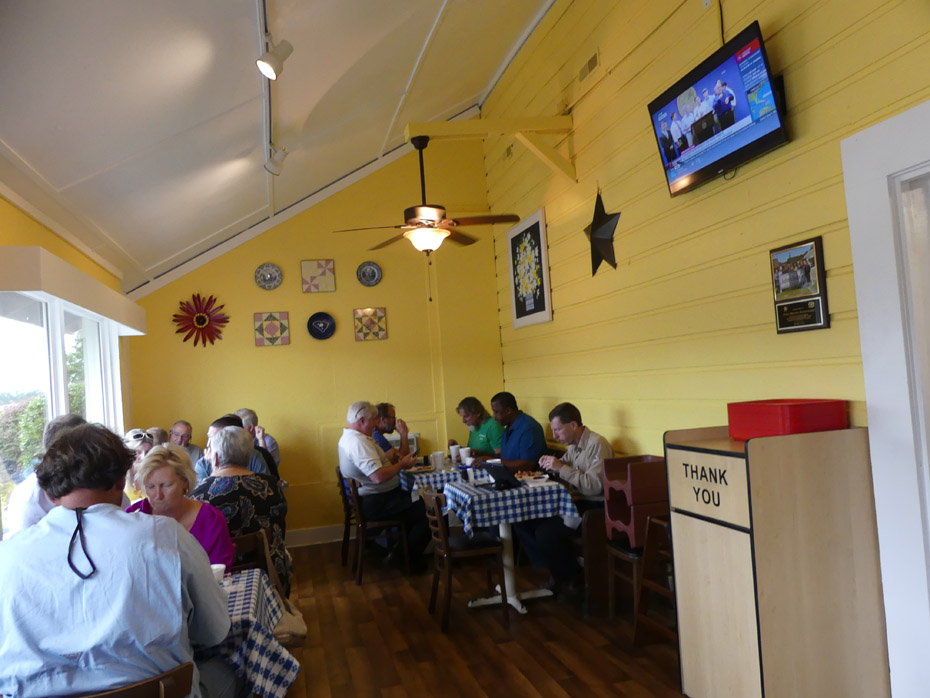 Diners seated at several tables at Julia Belle's in Pee Dee State Farmers Market