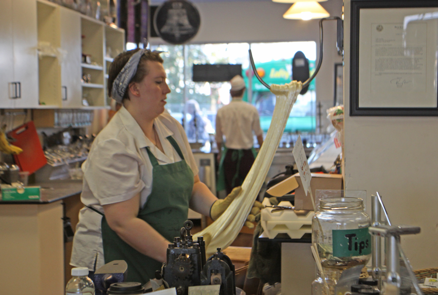 Candy maker pulling hot candy at Lofty Pursuits in Tallahassee, Florida