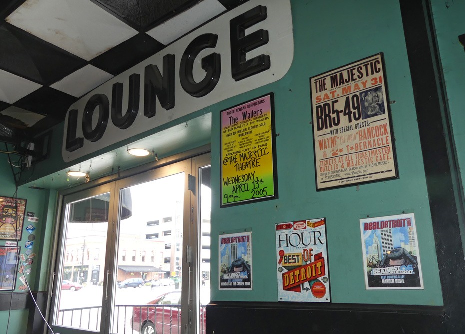 wall in Majestic with posters about bands