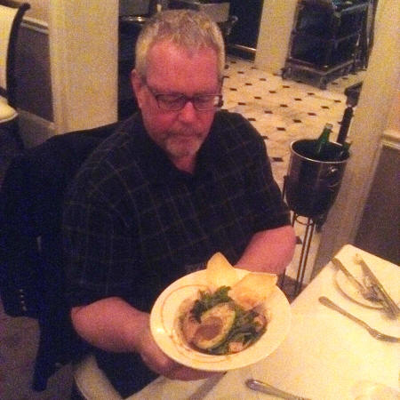 Man holding Satsuma Advacado Salad at Broussard's Restaurant in New Orleans