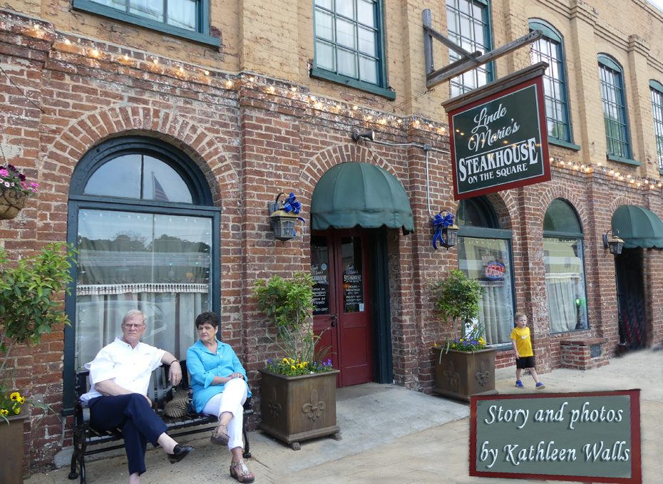 linde marie's steakhouse building wiht couple and little boy in front