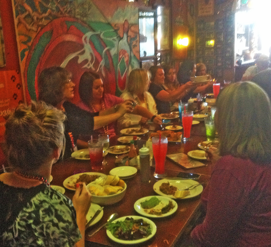 group of people seated at a long table at Zydeco's Restaurant in Mooresville, IN