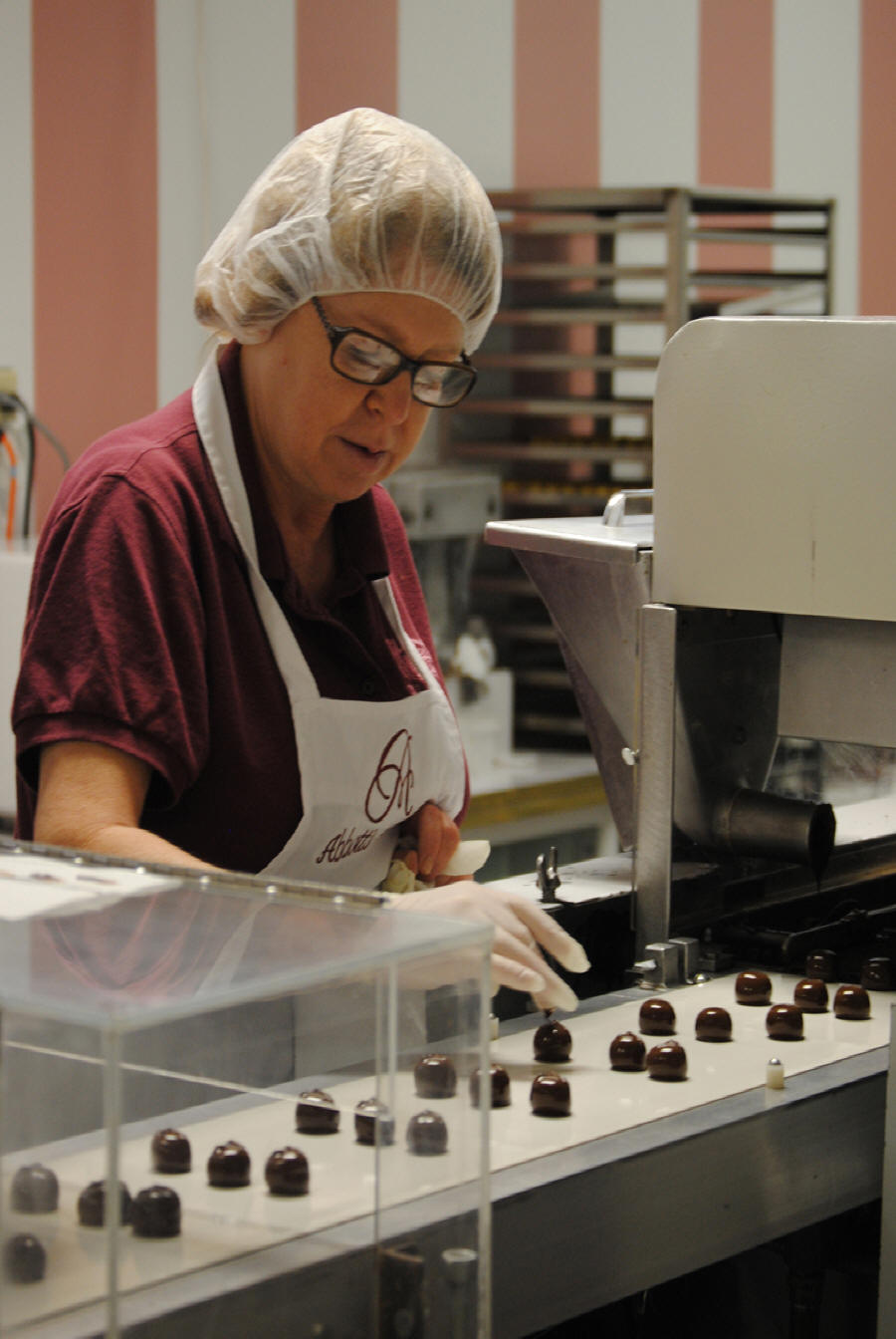 Chocolatier making candies at Abbots Candy Shop on Indiana's Chocolate Trail
