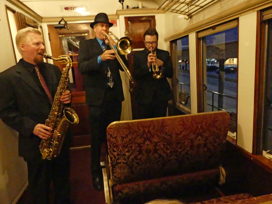 3 Jazz muscians play in front part of railcar on Vintage Railroad in Grapevine, TX