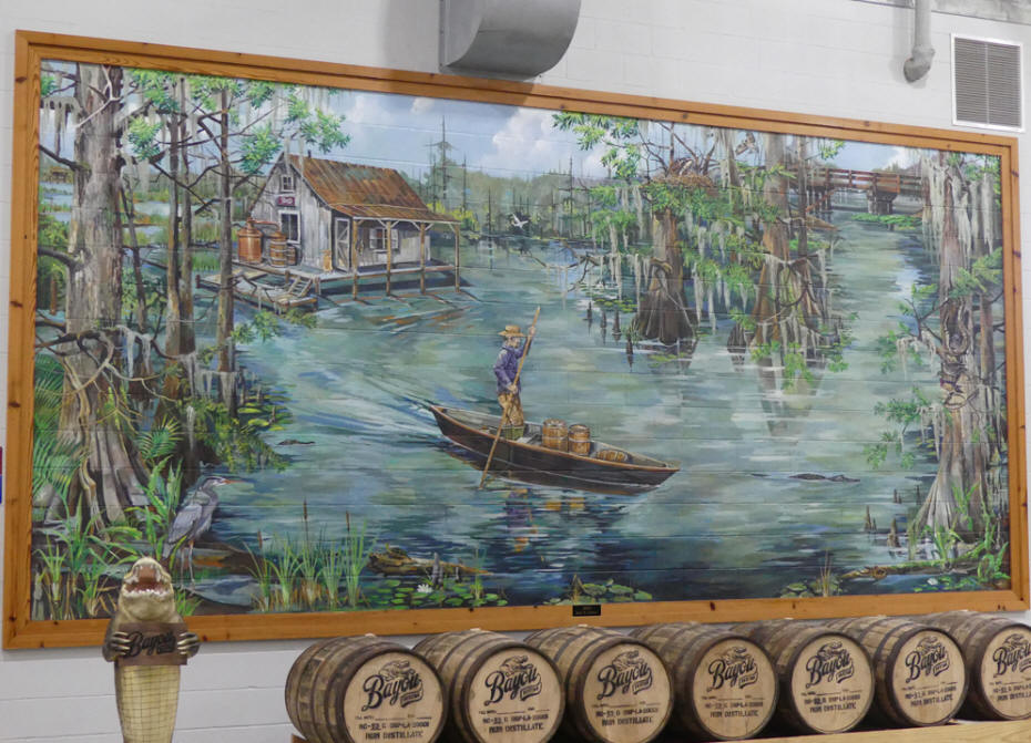 mural of still on bayou cabinand man in pirogure