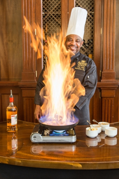 Chef preparing Bananas Foster at Bourbon Orleans in French Quarter of New Orleans