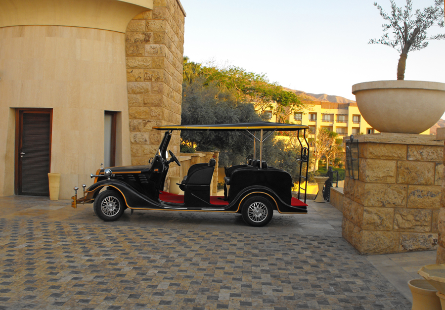 Golf cart decked out like model T  at Kempinsky Hotel Isthar by Dead Sea