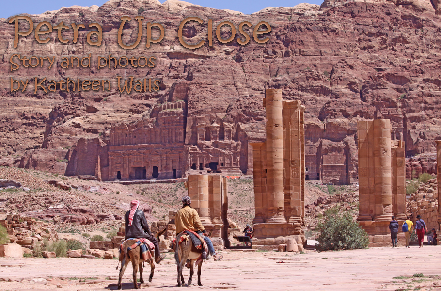 Petra with roman ampitheater in forground and tombs in background used as header