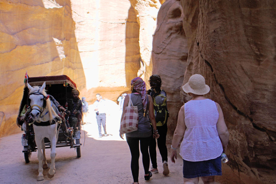 visitors and carriage in siq at Petra