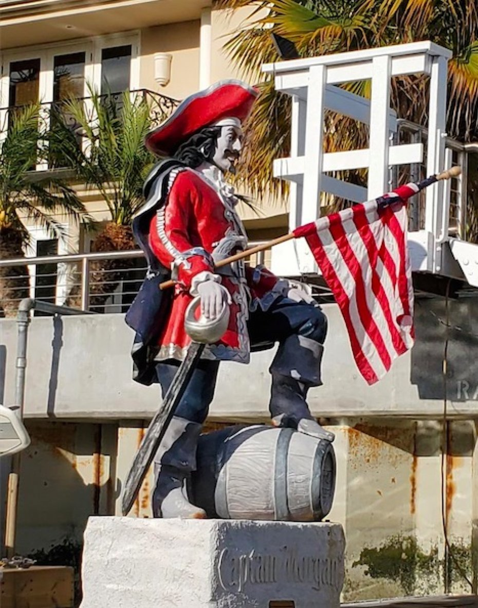 stature of Captain Morgan holding US flag