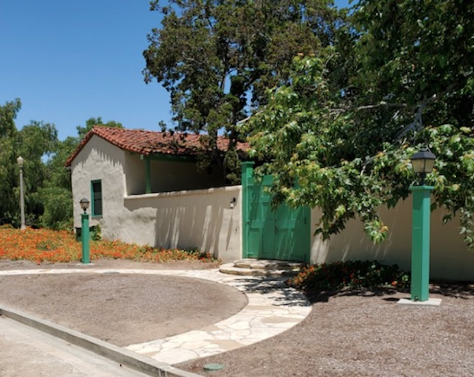 Adobe house with wall aroudn it