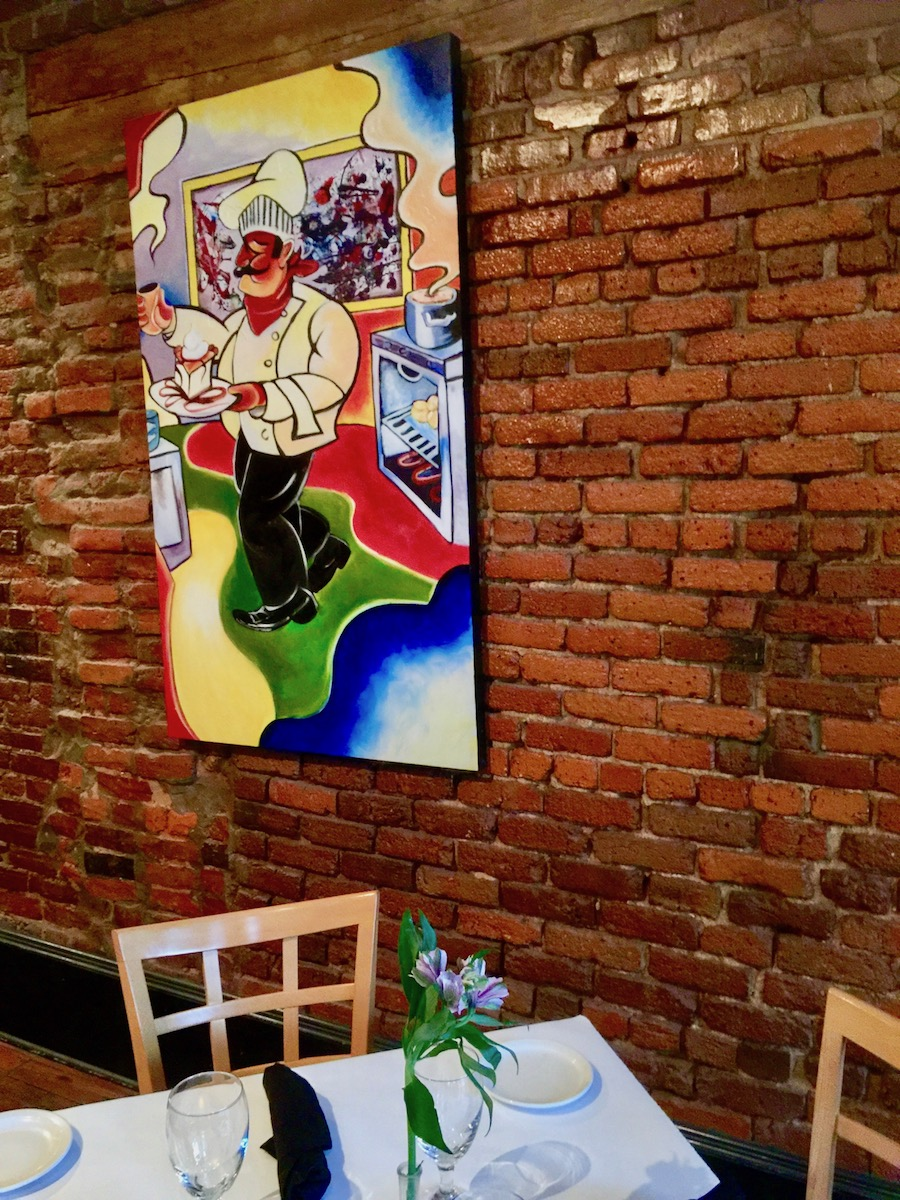 chef painting on brick wall in Valdosta GA