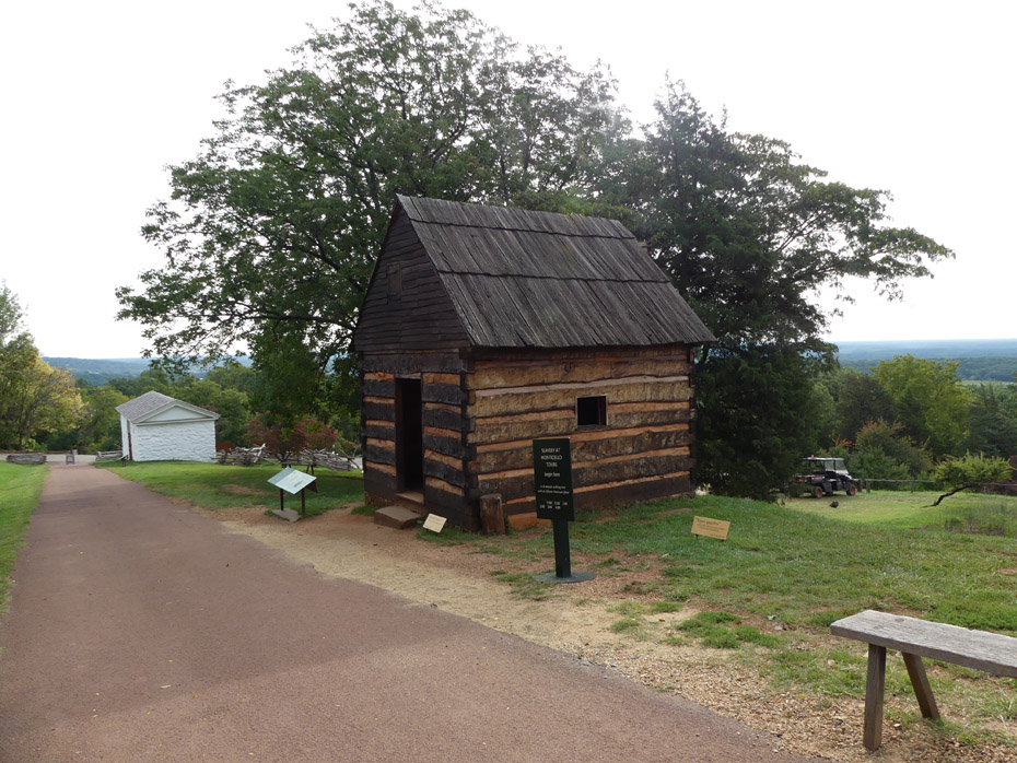 Hemmings Cabin with stable in background at Monticello
