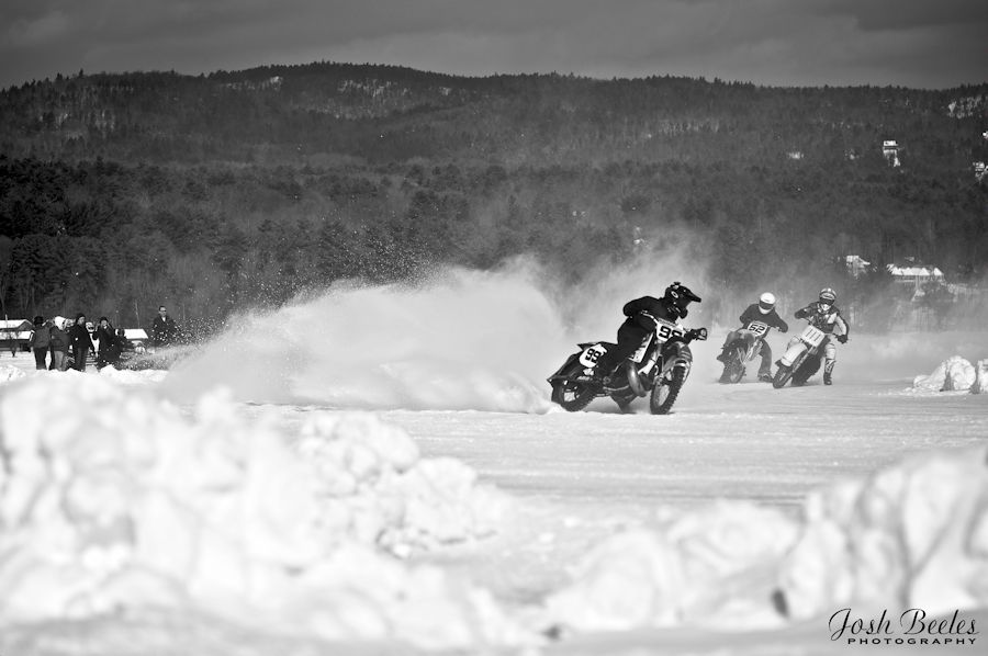 Motorcycles race over ice on Lake George