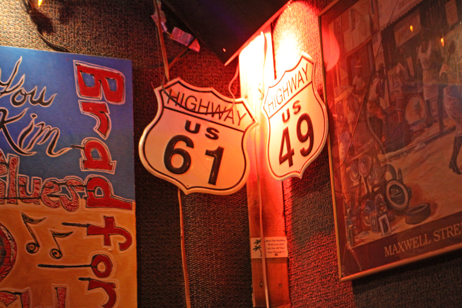 Highway 61 and 49 signs  at Bradfordville Blues Club in Tallahasseeof the Mississippi Crossroad