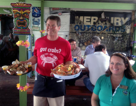 Waiter and Punta Gorda Mayor with seafood at Peace River Seafood