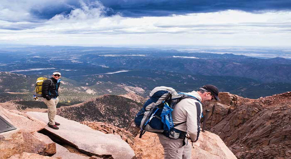 Two hikers at summit of Pikes Peak