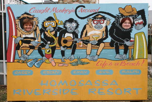 Women pose in sign at  Riverside Crab House in Homosassa, Florida