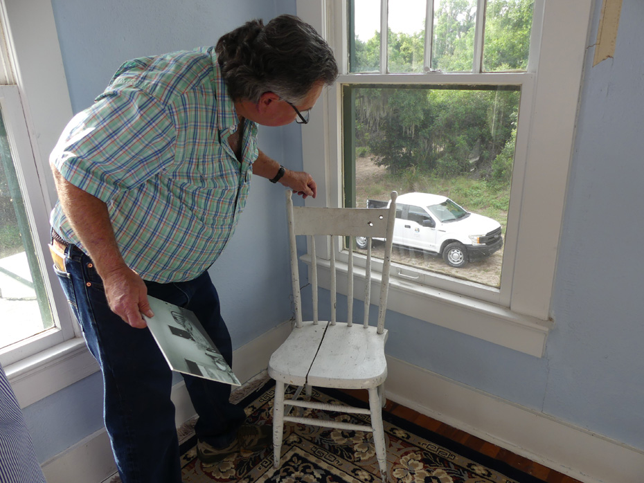 guide showing bullet holes in chair in Ma barker house