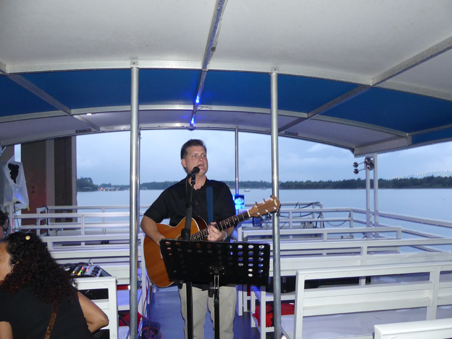 musician with guitar on ponton boat