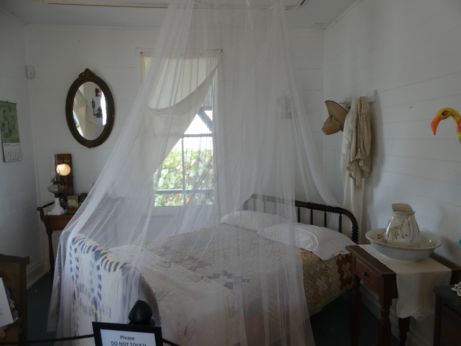 old fashioned bed wiht mosquiter netting